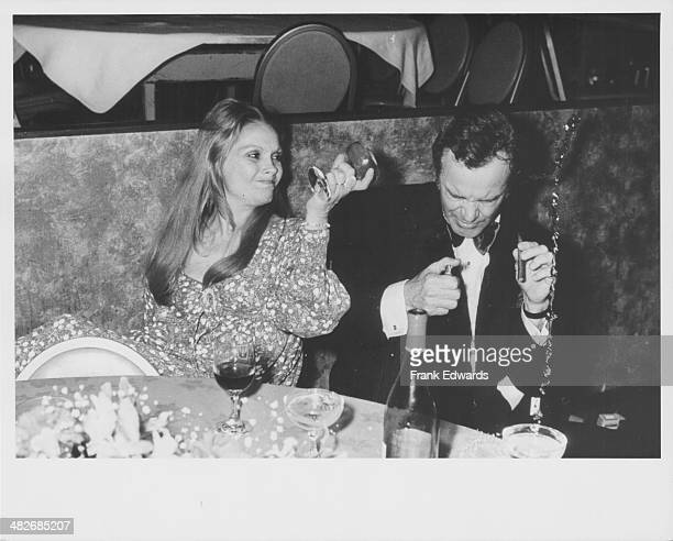 Actor Jack Lemmon having a drink thrown over him by his wife Felicia Farr at an American Film Institute Event Century Plaza Hotel California March...