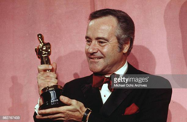 Actor Jack Lemmon poses backstage after winning Best Actor award during the 46th Academy Awards at Dorothy Chandler Pavilion in Los AngelesCalifornia