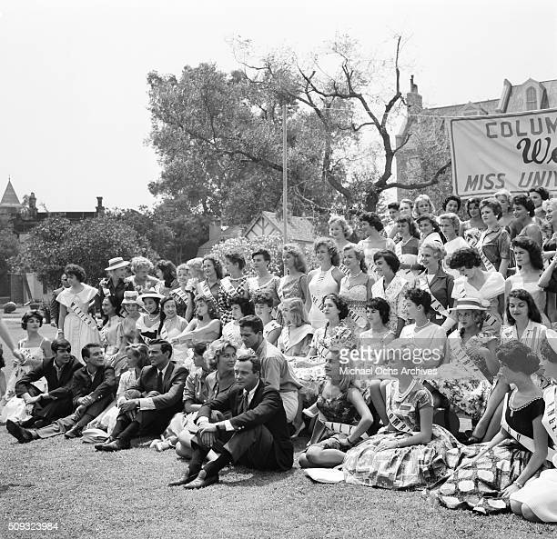 Actor Jack Lemmon poses with 1959 Miss Universe Contestants as Columbia Pictures welcomes the ladies in Long Beach California