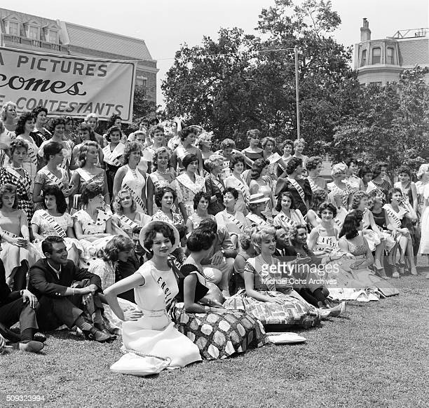Actor Jack Lemmon poses with 1959 Miss Universe Contestants as Columbia Pictures welcomes the ladies in Long Beach California'n 'nJack Lemmon