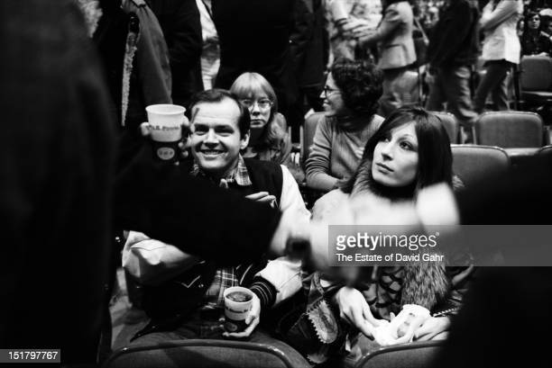 Actor Jack Nicholson and actress Anjelica Huston attend a performance by Bob Dylan and The Band at Madison Square Garden in January 1974 in New York...