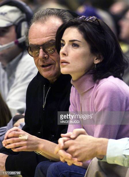 Actor Jack Nicholson and his girlfriend actress Laura FlynnBoyle watch the Los Angeles Lakers play the Vancouver Grizzlies at the Staples Center in...