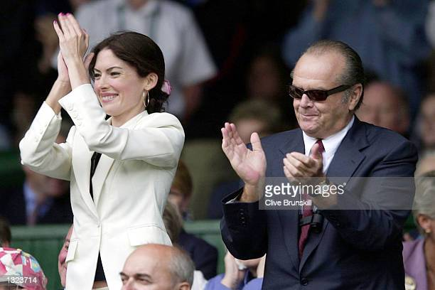 Actor Jack Nicholson and Lara Flynn Boyle applaud for Goran Ivanisevic''s of Croatia win over Patrick Rafter of Australia during the Men''s Final of...