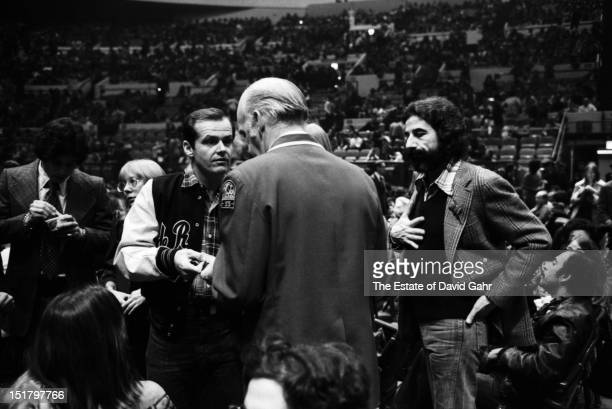 Actor Jack Nicholson and record producer Lou Adler confer with a theatre usher at a performance by Bob Dylan and The Band at Madison Square Garden in...