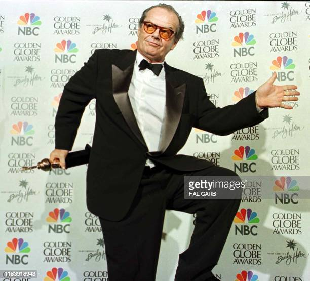 Actor Jack Nicholson dances for photographers after receiving the Cecile B DeMille Lifetime Achievement Award at the 56th Annual Golden Globe Awards...