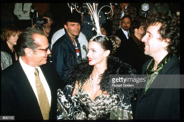 Actor Jack Nicholson director Tim Burton and his wife Lisa Marie attend the premiere of Mars Attacks at Mann's Chinese Theater December 12 1996 in...