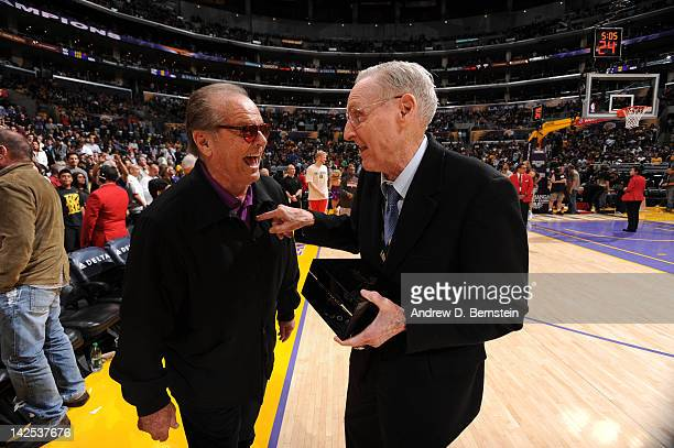 Actor Jack Nicholson greets former NBA player and coach Bill Sharman at halftime of a game between the Houston Rockets and the Los Angeles Lakers at...