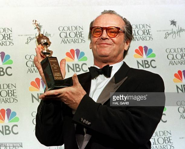 Actor Jack Nicholson holds the award he received at the 56th Annual Golden Globe Awards in Beverly Hills CA 24 January Nicholson won the Cecil B...