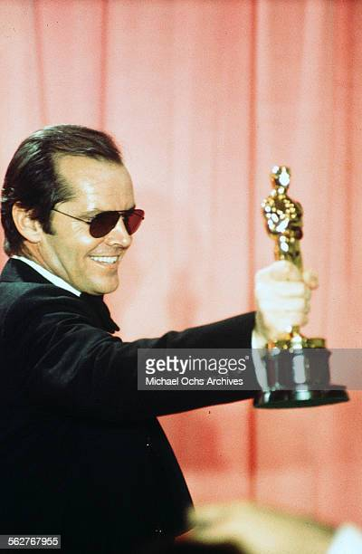 Actor Jack Nicholson pose backstage after winning Best Actor and Best Actress for One Flew Over the Cuckoo's Nest during the 48th Academy Awards at...