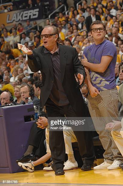 Actor Jack Nicholson shouts courtside as the Los Angeles Lakers take on the San Antonio Spurs in Game Five of the Western Conference Finals during...