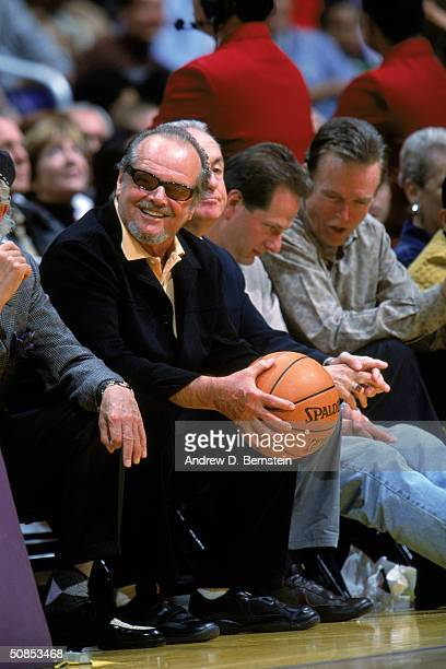 Actor Jack Nicholson sits courtside as he holds on to a basket ball in Game One of the Western Conference Quarterfinals between the Houston Rockets...