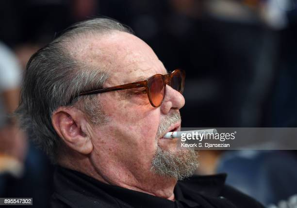 Actor Jack Nicholson sits courtside as the Los Angeles Lakers take on the Golden State Warriors where Laker legend Kobe Bryant's jersey was retired...