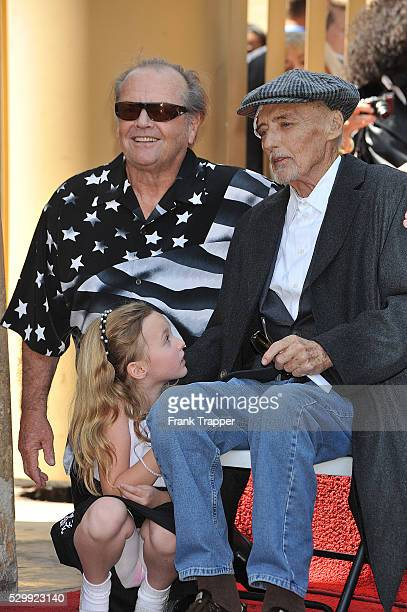 Actor Jack Nicholson talks to actor Dennis Hopper and daughter Galen Grier Hopper who was honored with the 2403rd Star on the Hollywood Walk of Fame