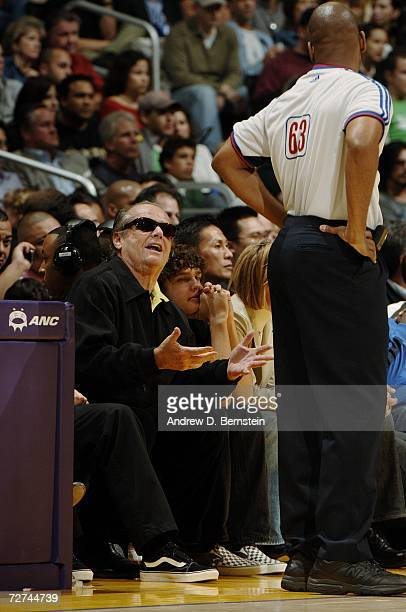 Actor Jack Nicholson talks with referee Derek Richardson during the game between the Los Angeles Lakers and the Toronto Raptors on November 17 2006...
