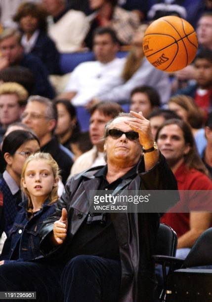 Actor Jack Nicholson tosses a ball back on the court as his daughter watches during game between the Los Angeles Lakers and the Orlando Magic 11...