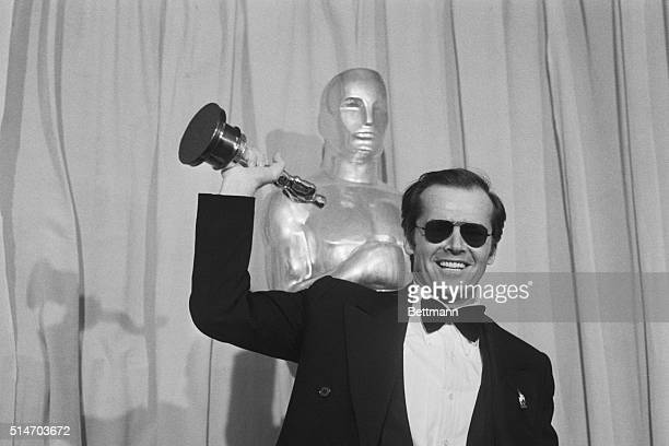 Actor Jack Nicholson waves his Oscar which he received for best actor in the film One Flew Over the Cuckoo's Nest at the 48th Annual Academy Awards