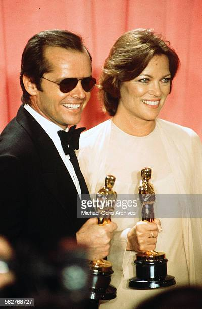 Actor Jack Nicholson with actress Louise Fletcher pose backstage after winning Best Actor and Best Actress for One Flew Over the Cuckoo's Nest during...