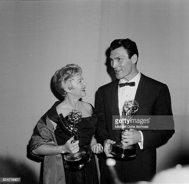 Actor Jack Palance and Claire Trevor pose with their Emmy Awards in Los AngelesCA