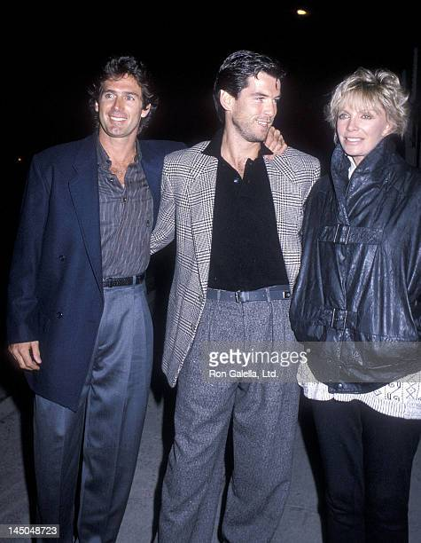 Actor Jack Scalia actor Pierce Brosnan and wife Cassandra Harris on September 25 1986 dine at Spago in West Hollywood California