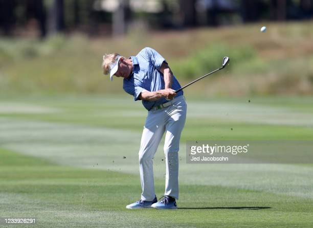 Actor Jack Wagner hits from the third hole during the final round of the American Century Championship at Edgewood Tahoe South golf course on July...