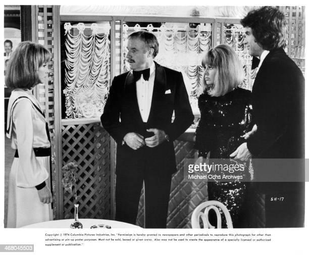 Actor Jack Warden actress Julie Christie and Warren Beatty on set of the movie Shampoo circa 1975