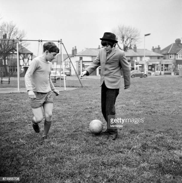 Actor Jack Wild who played the role of the Artful Dodger in the 1968 Lionel Bart musical film Oliver Pictured playing football with another boy in...
