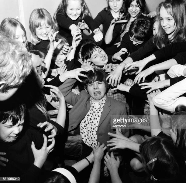 Actor Jack Wild who played the role of the Artful Dodger in the 1968 Lionel Bart musical film Oliver! Pictured messing around with other young...