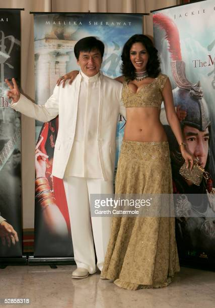 Actor Jackie Chan and actress Mallika Sherawat attend a photocall promoting the film 'Myth' at the Majestic Pier during the 58th International Cannes...