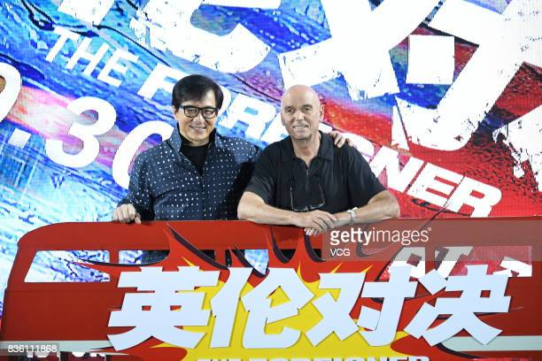 Actor Jackie Chan and director Martin Campbell attend 'The Foreigner' press conference on August 21 2017 in Beijing China