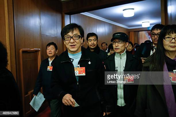 Actor Jackie Chan attends the third plenary session of China's parliament the National People's Congress at the Great Hall of the People on March 12...