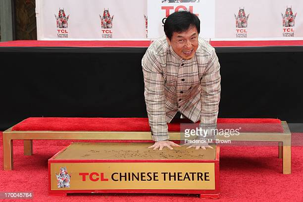 Actor Jackie Chan makes hand imprints during the Jackie Chan Hand and Foot Print Ceremony at the TCL Chinese Theatre on June 6 2013 in Hollywood...