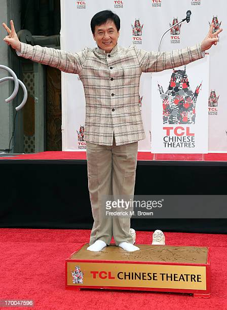 Actor Jackie Chan poses during the Jackie Chan Hand and Foot Print Ceremony at the TCL Chinese Theatre on June 6 2013 in Hollywood California