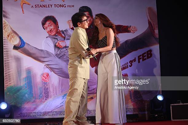 Actor Jackie Chan poses for photo with Indian actress Amyra Dastur during the promotion of his new movie 'Kung Fu Yoga' in Mumbai India on January 23...