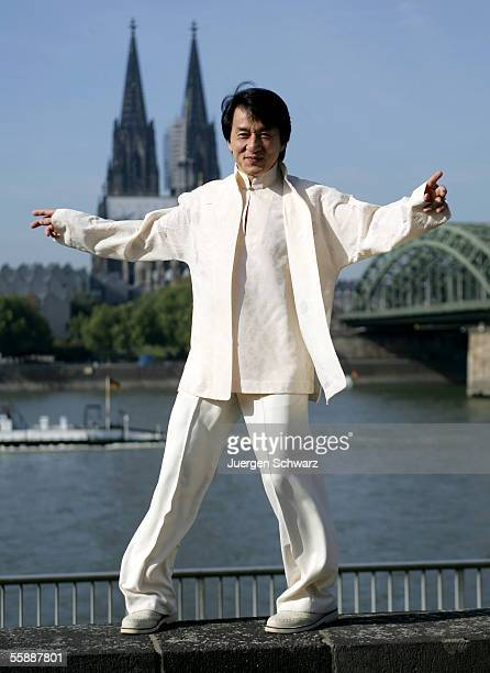 Actor Jackie Chan poses in front of Cologne Cathedral prior to tonight's premiere of his new film New Police Story on October 10 2005 in Cologne...