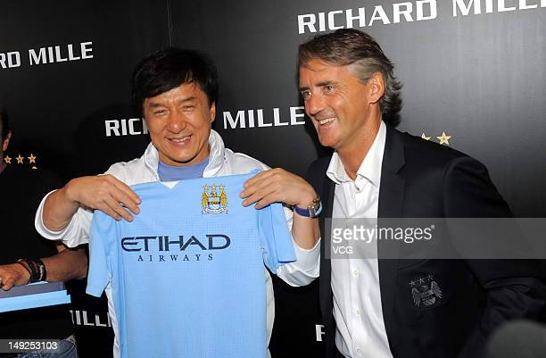 Actor Jackie Chan receives a jersey as gift from head coach of Manchester City Roberto Mancini during Richard Mille promotional event at Legendale...