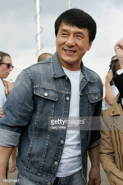 Actor Jackie Chan walks the red carpet at a special screening of his new movie Karate Kid at the Cinemark 17 on May 27 2010 in Dallas Texas