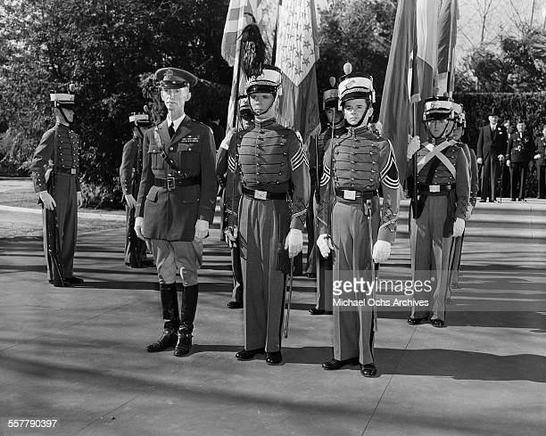 Actor Jackie Cooper and Freddie Bartholomew stand at attention on set of the movie Spirit of Culver