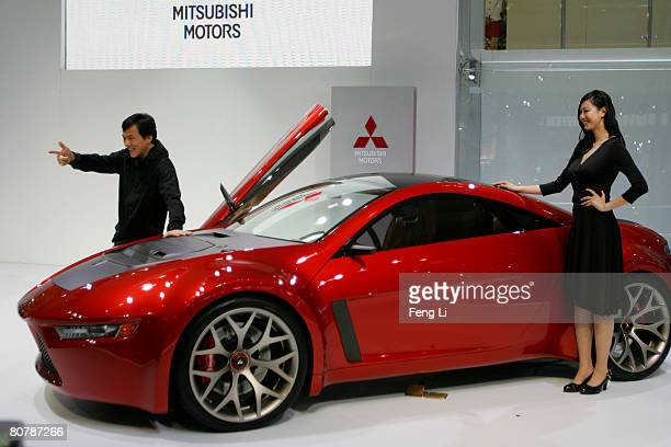 Actor Jacky Chan stands beside the concept car Mitsubishi ConceptRA during a special media opening of the Auto China 2008 show at the new China...