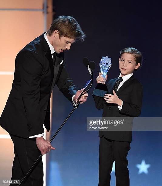 Actor Jacob Tremblay accepts Best Young Actor award from actor Bradley James onstage during the 21st Annual Critics' Choice Awards at Barker Hangar...
