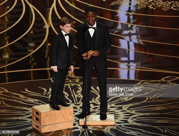 TOPSHOT Actor Jacob Tremblay and Actor Abraham Attah present on stage at the 88th Oscars on February 28 2016 in Hollywood California AFP PHOTO / MARK...