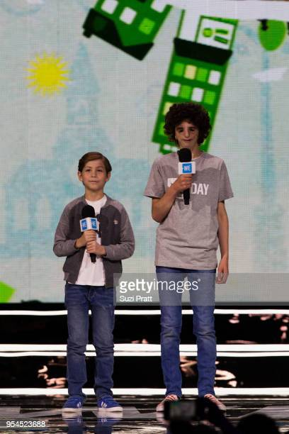 Actor Jacob Tremblay and spokesperson for Treacher Collins syndrome Nathaniel Newman speak at Key Arena on May 3 2018 in Seattle Washington