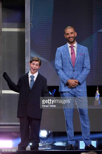 Actor Jacob Tremblay helps illusionist Darcy Oake perform a magic trick onstage at the 2018 NHL Awards presented by Hulu at The Joint inside the Hard...