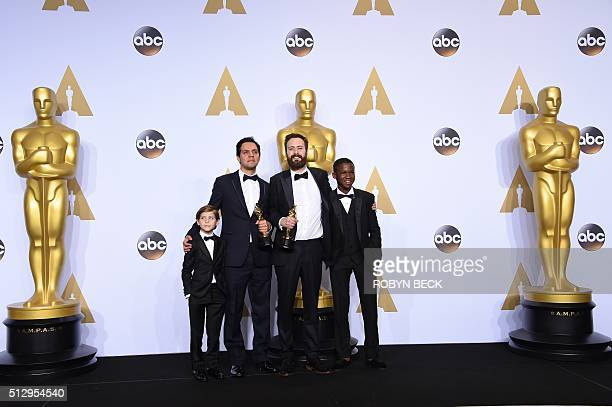 Actor Jacob Tremblay, Shan Christopher Ogilvie, Benjamin Cleary, winners of Best Live Action Short Film for 'Stutterer,' and actor Abraham Attah pose...