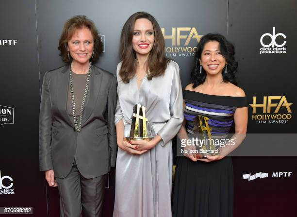 Actor Jacqueline Bisset and honorees Angelina Jolie and Loung Ung, recipients of the Hollywood Foreign Language Film Award for 'First They Killed My...