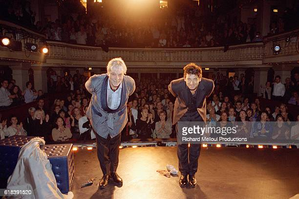 Actor Jacques Weber and actorsinger Patrick Bruel take a bow on stage at the Madeleine theatre