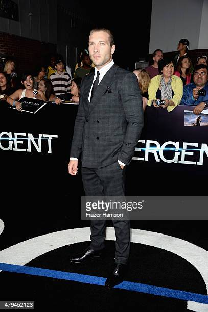 Actor Jai Courtney arrives at the premiere of Summit Entertainment's Divergent at the Regency Bruin Theatre on March 18 2014 in Los Angeles California