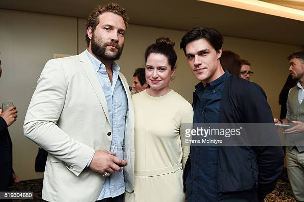 Actor Jai Courtney Sarah Roberts and actor Finn Wittrock attend the after party for the premiere of 'Be Here Now' at UTA Theater on April 5 2016 in...