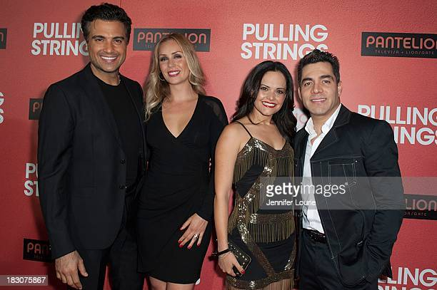 Actor Jaime Camil and wife Heidi Balvanera and actor Omar Chaparro and wife Lucia Ruiz de la Pena arrive at the Los Angeles premiere of 'Pulling...