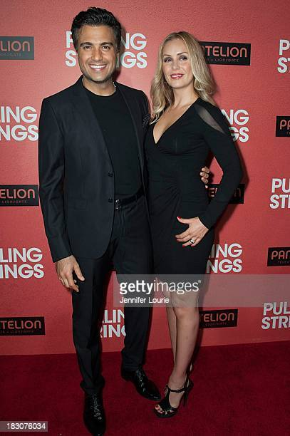 Actor Jaime Camil and wife Heidi Balvanera arrives at the Los Angeles premiere of 'Pulling Strings' at Regal Cinemas LA Live on October 3 2013 in Los...