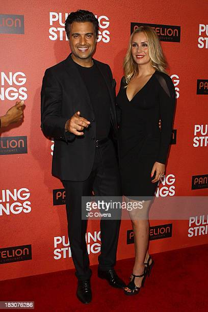 Actor Jaime Camil and wife Heidi Balvanera attend the Los Angeles Premiere of 'Pulling Strings' at Regal Cinemas LA Live on October 3 2013 in Los...